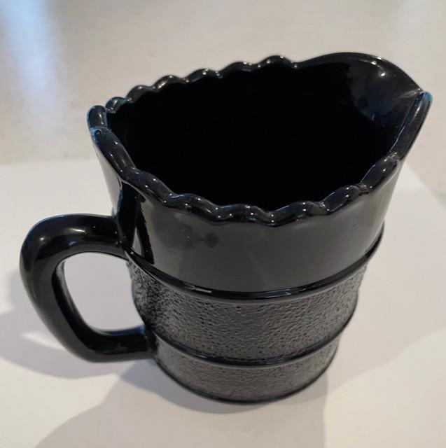 Moulded black glass jug